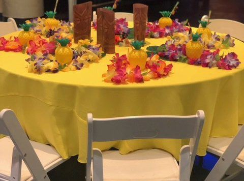 Table decorated in a luau theme